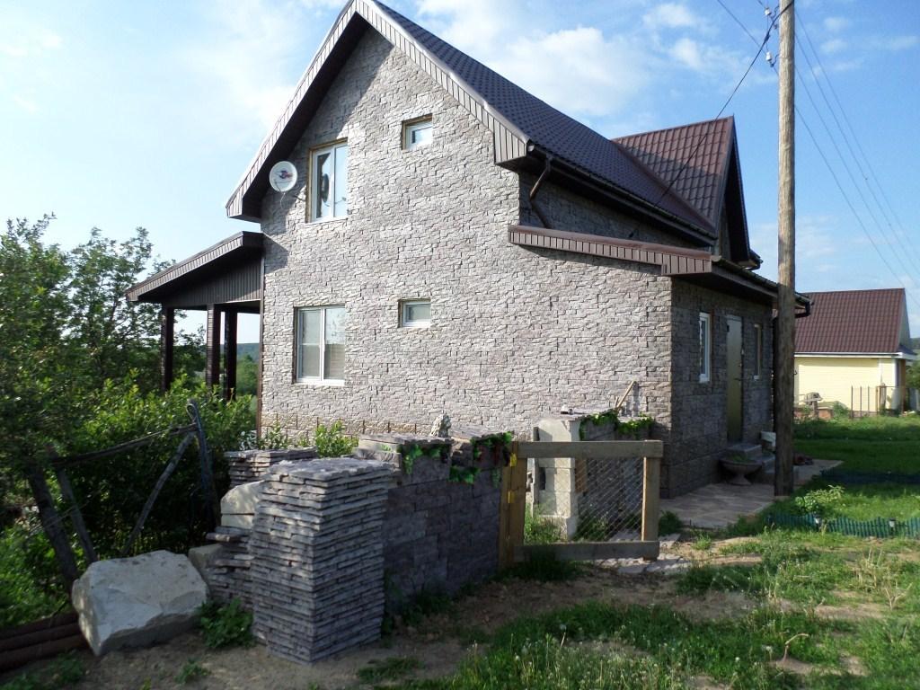 Облицовка газобетонного дома декоративными панелями из бетона