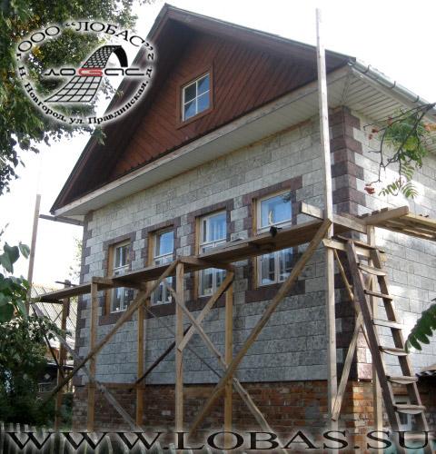 Дом после облицовки фасадной плиткой по технологии вентилируемого фасада
